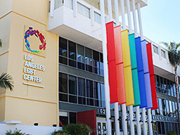 The Los Angeles LGBT Center - a large square building with coloured banners outside.