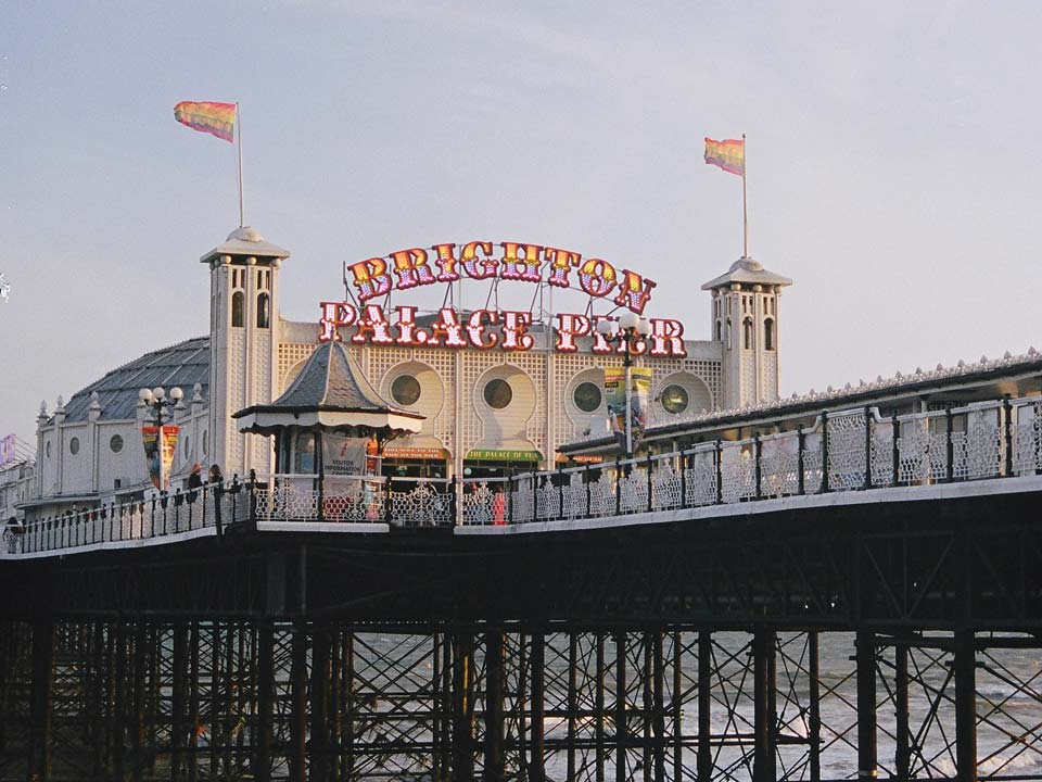 Pride flags flying at the entrance to Brighton Pier.