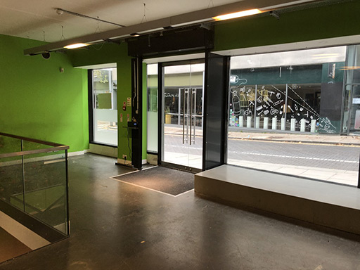 Looking through the glass doors and full-height windows onto Jubilee Street.